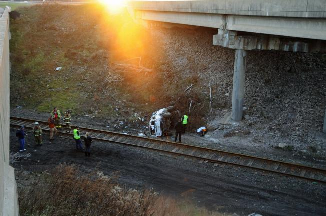 A Jeep Cherokee is pictured where it came to rest after leaving Interstate 81 in Schuylkill County Sunday and crashing down an embankment before coming to rest near railroad tracks between the north and southbound lanes of the interstate.