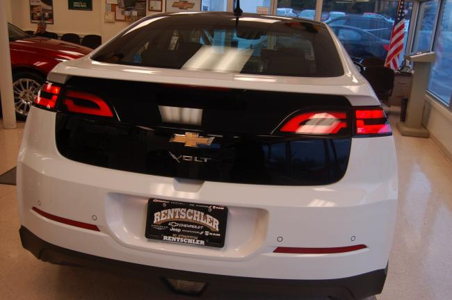 TERRY AHNER/TIMES NEWS Located inside the showroom of Rentschler Chevrolet Chrysler Jeep Dodge in Slatington, this white Chevy Volt is available for purchase.