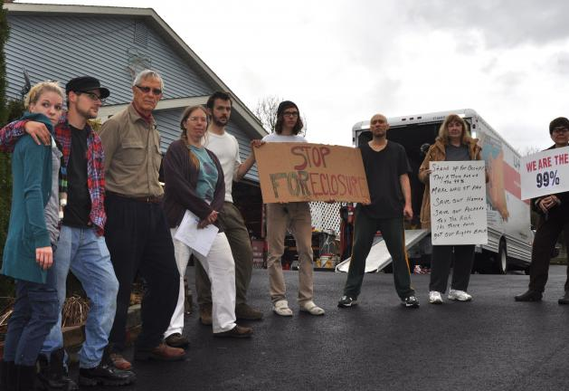 Members of Occupy Allentown, West Allentown and Bethlehem stage a rally at the Corio residence in Slatington on Tuesday. From left: Alyssa Santo, Adam Santo, Joris Rosse, Susie Buller, Daniel Hunter, Brad Ziegler, Phil Stein, Karen Samuels and Anne…