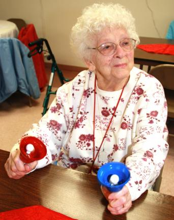 Majestic House resident Isabelle Brode, 89, shows her bell-playing abilities.