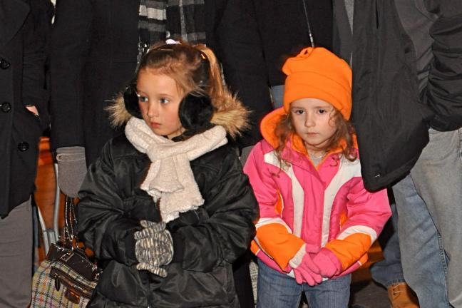 Five-year-old Dani Rimsky (left) and her cousin Kalla Miller, both from Jim Thorpe, enjoy the sights and sounds of the Christmas season.