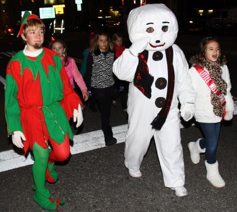 ANDREW LEIBENGUTH/TIMES NEWS Spreading Christmas cheer during the parade are Josh Gordon, 13, playing Santa's elf, Frosty, playingLinda Heigele and Madelyn Jones, 8, who was this year's Little Miss Spirit of Christmas.