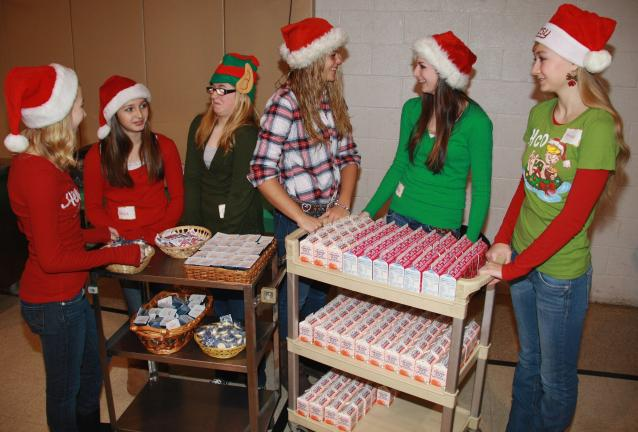 ANDREW LEIBENGUTH/TIMES NEWS Tamaqua Raider Cheerleaders who volunteered their time helping at the holiday event included, from left, Merranda Zehner, 13, Alissa Hollenbach, 12, Amy Bachert, 14, Gabby Freed, 15, Emily Ward, 15, and Krissy Gilbert, 16.