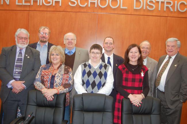 TERRY AHNER/TIMES NEWS Northern Lehigh School Board directors on hand for Monday's reorganizational meeting include (front row, l-r) Robin Distler, Natalie Green, Donna Kulp, Lauren Ganser (back row, l-r), Mathias Green, board President Edward…