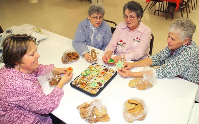ANDREW LEIBENGUTH/TIMES NEWS Sitting with their homemade cookies during a recent fundraiser at Christ Church in McKeensburg are volunteers, from left, Susan Mantz, Dorothy Faust, President Helen Koch and Nancy Shellhamer.