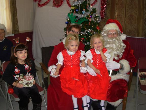 ADELE R. ARGOT/SPECIAL TO THE TIMES NEWS Twin sisters, left, Kayla Kormann, and right, Erika Kormann, of Forest Inn (Lehighton) came to visit Mr. and Mrs. Santa Claus at the Western Pocono Lioness hosted breakfast. They are 3 1/2 years old and are…