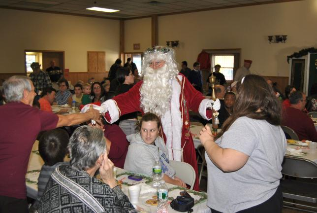SPECIAL TO THE TIMES NEWS Santa Claus greets guests at the 18th annual Blue Ridge Food and Toy Drive banquet held recently at the Aquashicola Fire Company.