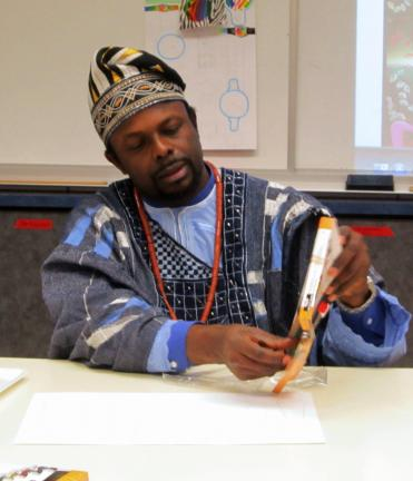 HEATHER BACSICK/SPECIAL TO THE TIMES NEWS Arts Ambassador for Nigeria, Ibiyinka Alao, prepares to conduct an art workshop with students at Jim Thorpe Area High School.