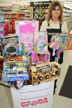 ANDREW LEIBENGUTH/TIMES NEWS Employees and customers of the Dollar General in Tamaqua helped provide many donations to the Schuylkill Carbon Marine Corps League's annual Toys For Tots drive, as well as provided many other items needed for various…