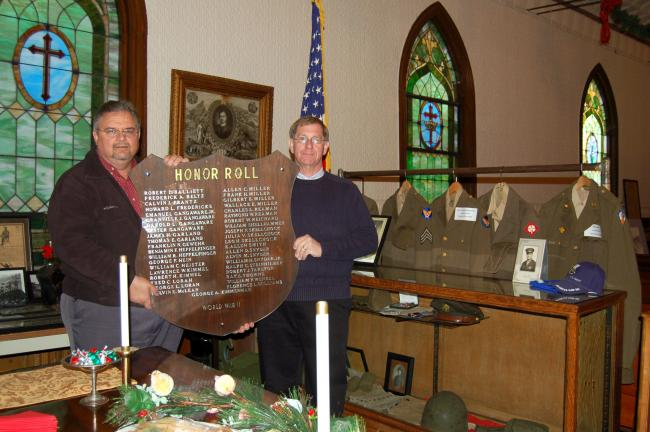 CHRIS PARKER/TIMES NEWS Lansford Historical Society secretary Dale Freudenberger, left, and president Bill Harleman hold a World War II Honor Roll plaque
