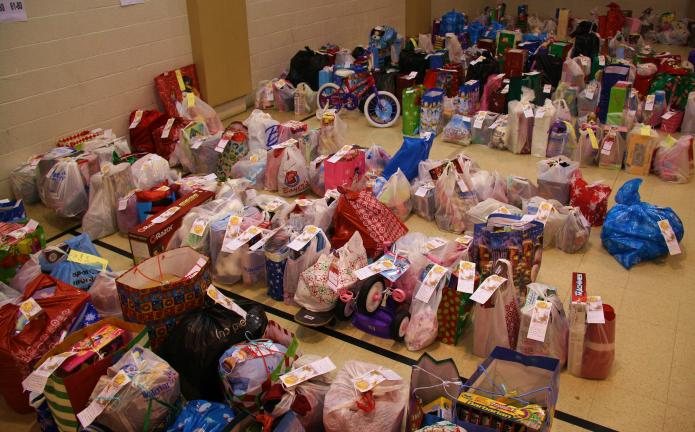 ANDREW LEIBENGUTH/TIMES NEWS Hundreds of Angel Tree gift bags filled the gymnasium of the Tamaqua Salvation Army Corps last night in preparation for the Salvation Army Angel tree toy and food distribution held this morning at the Corps.