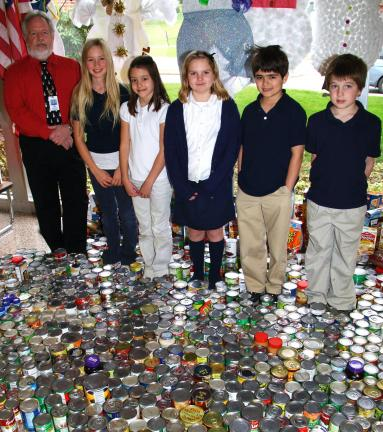 ANDREW LEIBENGUTH/TIMES NEWS Students in grades kindergarten to 5th grade opened their hearts as they brought in 1,074 food items for the Tamaqua Salvation Army's food pantry. The Tamaqua Salvation Army provides food year round to needy families. Mr…
