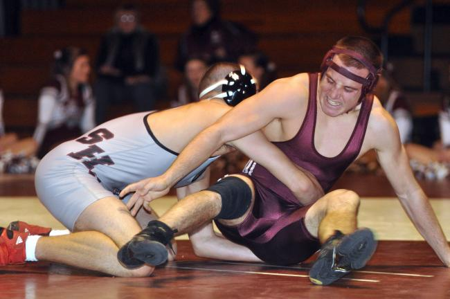mike feifel/times news Lehighton's Anthony Farole (right) works to escape the hold of Stroudsburg's Kevin Merle. Farole went on to pin Merle.
