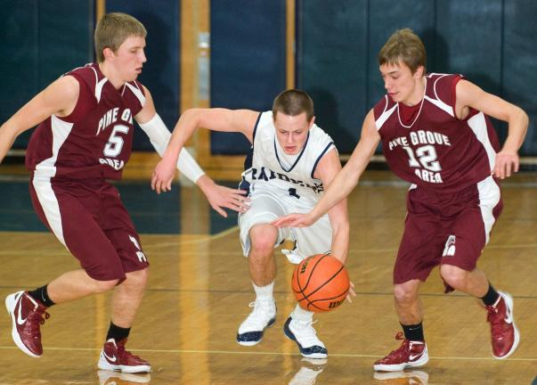 bob ford/times news Tamaqua's Jake Fegley (center) tries to split Pine Grove defenders Chris Rossi (5) and Adam Gerber.