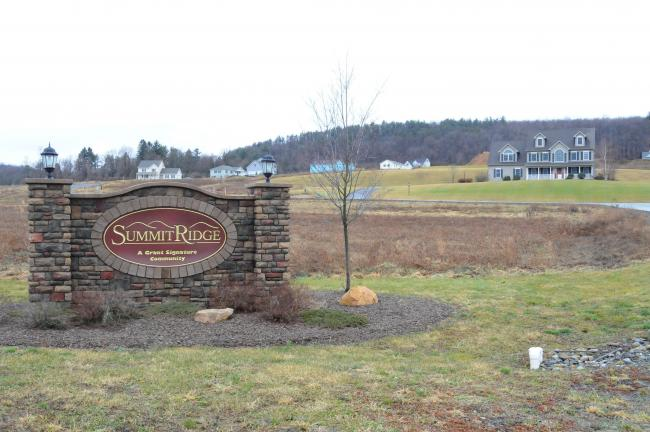 Ron Gower/TIMES NEWS Richard Maglionico, sales manager at the Summit Ridge Development in Mahoning Township, said the development was started about five years ago and then the real estate bust occurred. He said he anticipates new homes to soon go…
