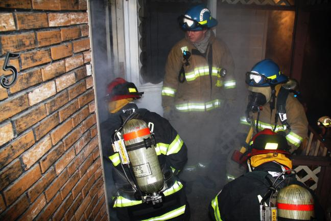 ANDREW LEIBENGUTH/TIMES NEWS Tamaqua firefighters from American Hose Company, Rescue Squad and South Ward fire companies don masks for their live training exercise.