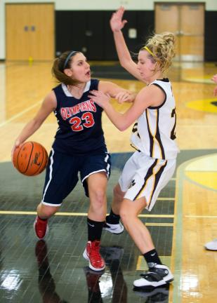 bob ford/times news Jim Thorpe's Chasity Mosteller (23) drives to the basket against Panther Valley's Olivia Markovich.