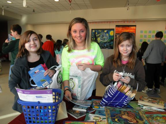 Special to the TIMES NEWS  These fifth grade students are all smiles as they participate in the fifth annual Book Swap recently at Slatington Elementary.