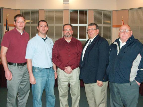 MIKE HEERY/Special to THE TIMES NEWS Welcoming new Lehighton Indians head football coach Tom McCarroll (second from left) are (left to right) Kyle Spotts, Director of Student Services and Facility Planning; Rocky Ahner, Lehighton Area School Board…
