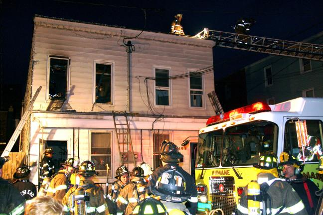 ANDREW LEIBENGUTH/TIMES NEWS Firefighters were quick to respond and quell a fast moving fire yesterday evening at a duplex home located at 409 and 411 West Market Street in Mahanoy City.