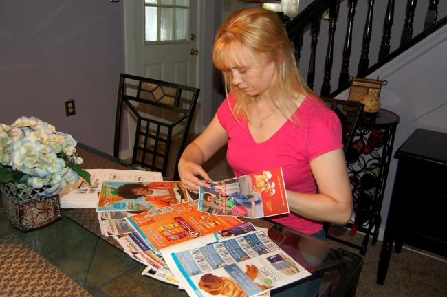 CHRIS PARKER/TIMES NEWS Laura Kennedy of Hometown spends a few hours a week clipping coupons and coordinating sales to save big bucks.