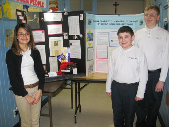 SPECIAL TO THE TIMES NEWS History projects will be displayed as part of Catholic Schools Week at OLOA, Lansford, including those presented by Andria Ahrens, left, and Joshua Jurick, middle, and Scott Faust.