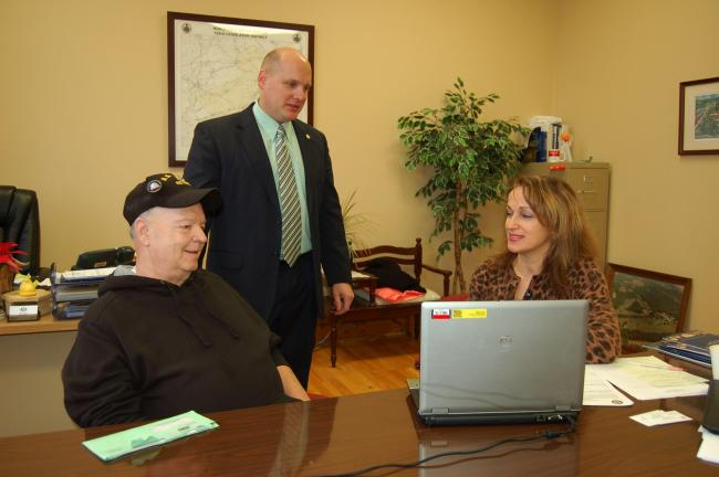 Gail Maholick/TIMES NEWS Marta Gabriel, Senator Patrick J. Toomey's Lehigh Valley regional manager, was at State Rep. Doyle Heffley's Lehighton office all day on Thursday to help local residents with federal issues. From left are, Robert Graver of…