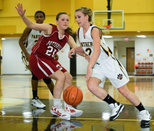 Bob Ford/TIMES NEWS Panther Valley's Abbey Whildin drives past Meghan Boran of Pottsville during Friday's Schuylkill League Division 1 game.
