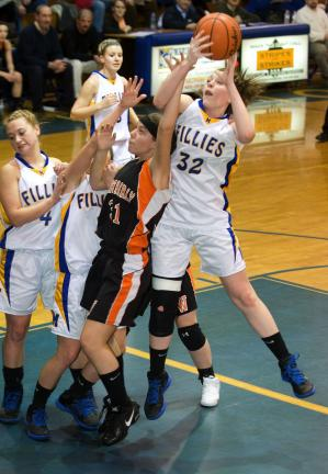 bob ford/times news Marian's Kelly Shober (32) goes up to grab a rebound over Weatherly's Alexis Boyarski (31)