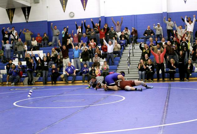 Rich George/Special to the TIMES NEWS Palmerton fans react during Skyler Rosenberry's recent matchup with Bangor's Andrew Lumsden. The Blue Bombers are hoping to reach the initial Colonial League wrestling playoffs, which will take place on Feb. 18.