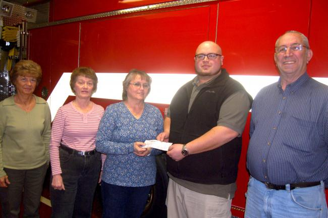 TERRY AHNER/TIMES NEWS Patsy Beaber (center), president of the Bowmanstown Auxiliary, presents a $5,000 donation to Daniel Koch (second from right), treasurer of the Bowmanstown Fire Company, to be used toward its general fund. Also pictured are…