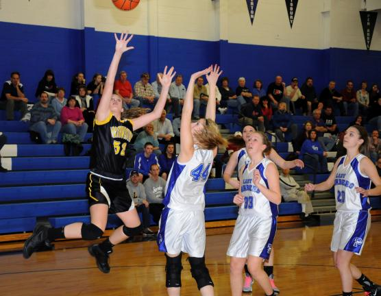 Ron gower/times news Northwestern's Sarah Segan (left) puts up a shot over Palmerton defenders Kelsey Hay (44), Jennifer Snyder (33) and Morgan Mummey (20).