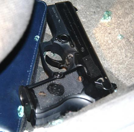 ANDREW LEIBENGUTH/TIMES NEWS Pictured is a gun lying loosely on the front passenger seat's floor.