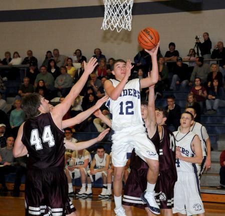 Tamaqua's Adam Frantz drives to the basket past Lehighton defender Jacen Nalesnik during Saturday's non-league game. The Indians went on to post a 57-55 overtime win. RON GOWER/ TIMES NEWS