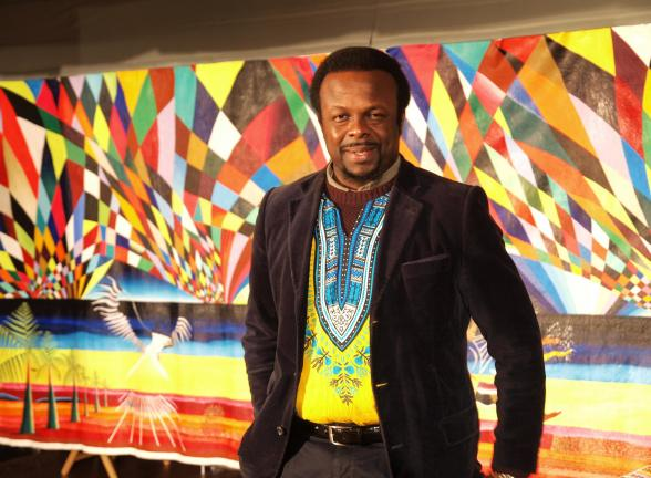 AL ZAGOFSKY/SPECIAL TO THE TIMES NEWS Award-wining African artist and Arts Ambassador for Nigeria to the United Nations Ibiyinka Alao with his painting The Eagle. Alao 's exhibition, Eternity in Our Hearts opens Feb. 21 at the Mauch Chunk Museum.