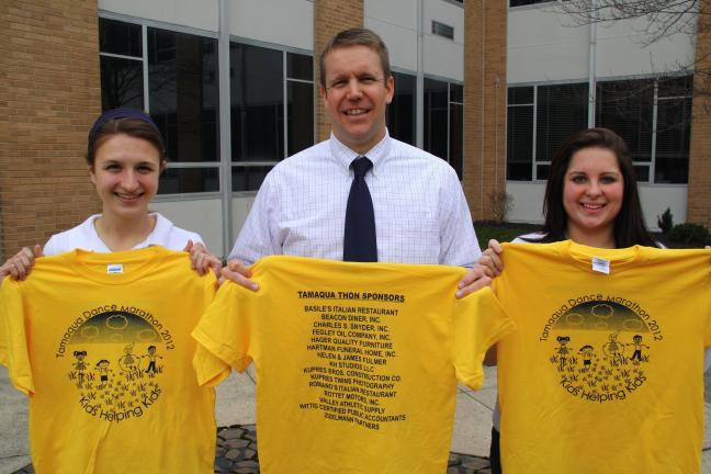 ANDREW LEIBENGUTH/TIMES NEWS Pictured holding sponsored T-shirts are senior Kelsey Patrick, 17, vice president, TASG; teacher Steve Ulicny, advisor, TASG; and senior Emily Zancofsky, 17, president, TASG.