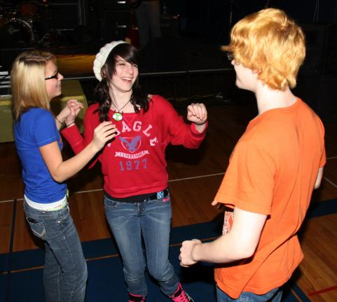 ANDREW LEIBENGUTH/TIMES NEWS Gabe Bumberger, 16, dances with two girls, Sam White, 15, center, and Samantha Fidler, 14.