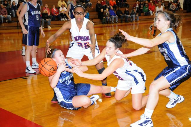 RON GOWER/TIMES NEWS Jim Thorpe's Chelsea Smelas, white uniform on floor, knocks ball away from Blue Mountain's Anne Schu, while looking on are the Olympians' Celeste Robinson (22) and Blue Mountain's Joelle Moyer.