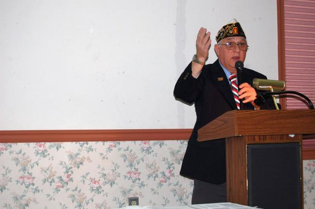 David Altrichter, a member of American Legion Post 16, explains traditions of the American flag.