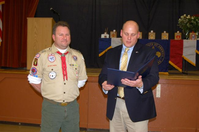 Gail Maholick/TIMES NEWS Scot Wingert, scoutmaster of Boy Scout Troop 82, Lehighton, is presented a House of Representatives citation by State Rep. Doyle Heffley, right.