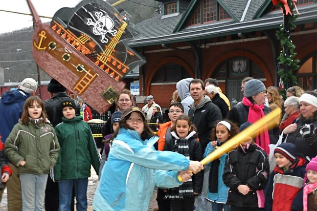 Nine-year-old Elizabeth Horton from Morristown, N.J. takes a hard-hitting swing at a pinata in Josiah White Park during her family's visit to Jim Thorpe during the Jim Thorpe Chamber of Commerce's 18th Annual WinterFest Weekend.