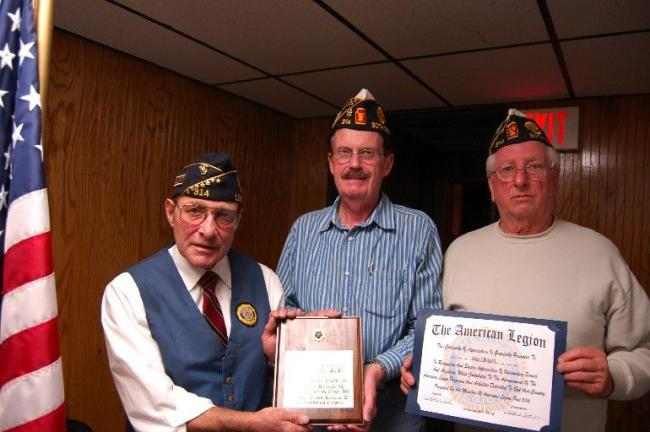Gail Maholick/TIMES NEWS Harry Wynn III, center, was recognized with a plaque and a citation by the American Legion Post 314, Lehighton, for his years of dedicated service. From left are, Richard Fink, adjutant and secretary; Wynn; and Floyd Brown,…