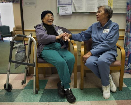 SHNS PHOTO BY RANDY PENCH/THE SACRAMENTO BEE Loretha Loggins, 83, right, visits with client Anna Chow, 87.