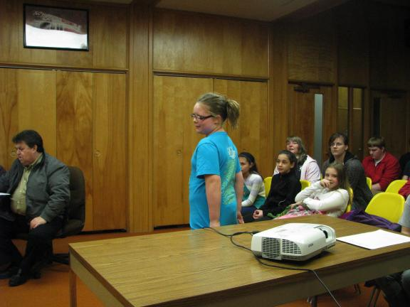 LIZ PINKEY/SPECIAL TO THE TIMES NEWS Jessica Ohl, (standing, center) a member of Girl Scout Troop 31106, and other members of her troop, requested Tamaqua Borough Council's approval for several community cleanup projects they are planning for the spring.