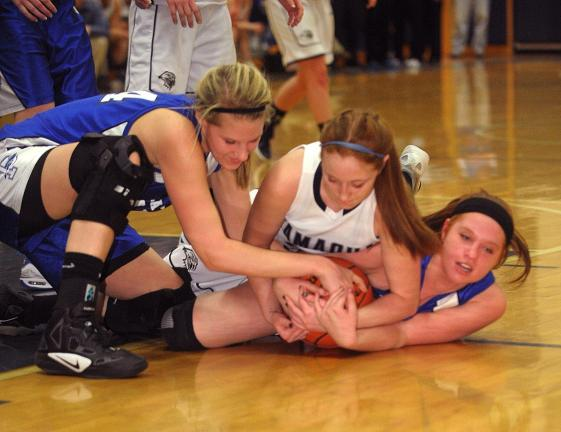 BOB FORD/TIMES NEWS Palmerton's Kelsey Hay (left) and Emily Meinhart (right) battle with Tamaqua Jaclin Valasek for control of the ball.