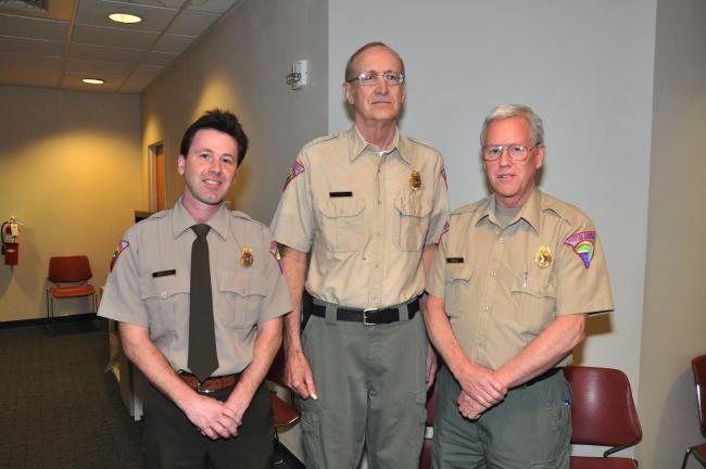 AMY MILLER/TIMES NEWS Park Rangers Gene Sheard, center, and Gerard Healy, right, stand with park director Dave Horvath. Sheard and Healy were recognized on Thursday by the Carbon County Commissioners for saving the lives of two boaters who fell into…