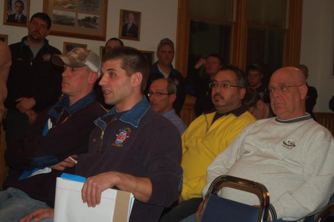 TERRY AHNER/TIMES NEWS Volunteer firefighter Jereme Barkanic, front, tells borough council it should send back the grant money it received to build a brand new fire station.