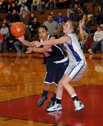 ron gower/times news Jim Thorpe's Nina Batts (left) passes the ball to a teammate as Blue Mountain's Elizabeth Kerns defends.
