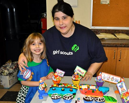"Albrightsville Troop 30137 Daisy Olivia Rosenberger and her mother Lisa stand by her entry ""Candy Circus"" which won Most Creative at the Service Unit 309, 2012 Girl Scout Bake Off which was held at Saint John's Lutheran Church on North Street in Jim…"