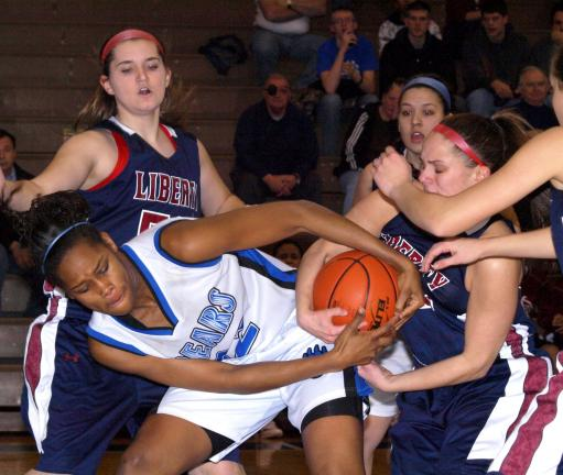 LINDA ROTHROCK/SPECIAL TO THE TIMES NEWS Pleasant Valley's KelecIa Harris (left) and Liberty's JodY Chickey battle for possession during Tuesday night's District 11 AAAA Girls semifinal at Nazareth.
